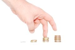 hand is stepping up on coins Royalty Free Stock Photography