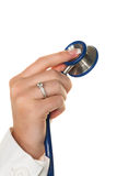 Hand with stethoscope Stock Images