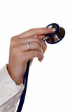 Hand with stethoscope Royalty Free Stock Image