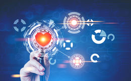 Hand with a stethoscope, heart, HUD, blue. Hand with a stethoscope and a bright red heart with HUD and infographics is seen against a blurred dark blue royalty free stock images