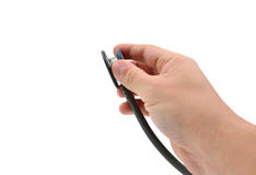 Hand with stetoscope. Isolated on white background Stock Photo