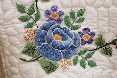 Hand stitched Embroidered flower on an Amish Quilt. Hand-stitched embroidered flower spotted on an Amish quilt at a rural farm auction in Delaware Stock Images