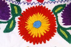Hand stitched fabric with a colourful flower Stock Photos
