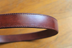 Hand-stitched leather belt royalty free stock image