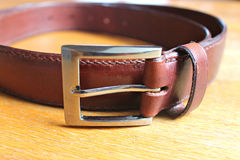 Hand-stitched leather belt stock photography