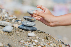 Hand with a stone. Women's hand with a grey stone Stock Photo