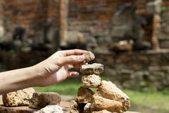 Hand with stone heap Stock Photography