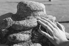 Hand and stone Royalty Free Stock Photo