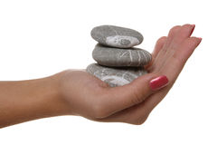 Hand and stones royalty free stock photography