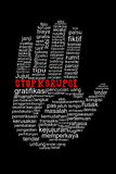 Hand with Stop Corruption text in indonesia language Stock Photo