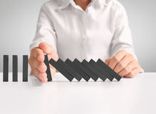 Hand stop  dominoes continuous toppled Stock Image