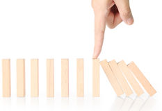Hand stop dominoes continuous toppled. Hand stop a dominoes continuous toppled stock images