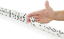 Hand stop dominoes continuous toppled Royalty Free Stock Photos