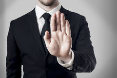 Hand stop. Man in suite holding hand stop royalty free stock images