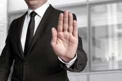Hand stop shown by businessman Stock Photography