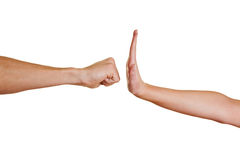 Hand stopping fist. Hand with open palm stopping angry clenched fist Stock Images
