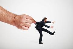 Hand stopping running man Stock Photo