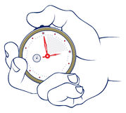 Hand and stopwatch Stock Images