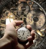 Hand with stopwatch and clockwork inside Royalty Free Stock Photo
