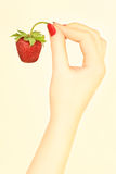 Hand with strawberry Royalty Free Stock Photos