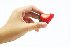 Hand on Strawberry bite Royalty Free Stock Photography