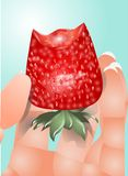 Hand with a strawberry Royalty Free Stock Photography