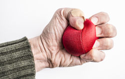 Hand of stressed man squeezing ball Stock Photos