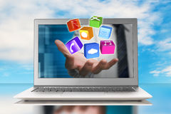Hand stretch out laptop screen with app blocks Royalty Free Stock Photography
