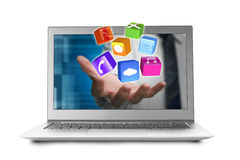 Hand stretch out notebook screen with app blocks Royalty Free Stock Photos