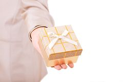 Hand stretched with a present box Stock Images