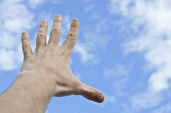 Hand stretched to the blue sky Royalty Free Stock Photo