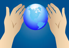 Hand stretched to globe Stock Photo