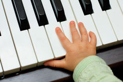 Hand Stretches. Baby warming up to play the piano Royalty Free Stock Photo