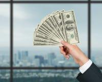 Hand stretches money Stock Image