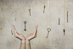 Hand stretching for one of the many old vintage keys Stock Photography