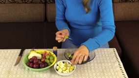 Hand string grape pear fruit on  stick and put pan on table stock video footage
