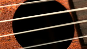 Hand strumming guitar strings close up stock video footage