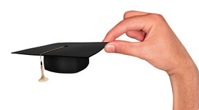 Hand with student cap stock images