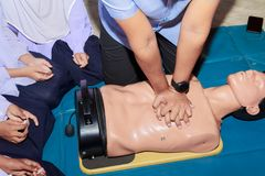Hand student Heart pump with medical dummy on CPR, in emergency refresher training to assist of physician.  stock photography