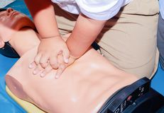 Hand student Heart pump with medical dummy on CPR, in emergency refresher training to assist of physician.  stock image