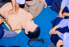 Hand student Heart pump with medical dummy on CPR, in emergency refresher training to assist of physician.  royalty free stock photo