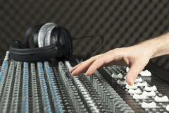 Hand on a studio mixer Stock Photos