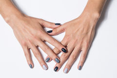 Hand with a stylish gray manicure isolated on Stock Photos