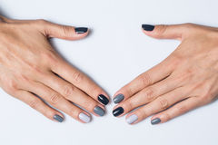 Hand with a stylish gray manicure isolated on Stock Photo