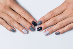Hand with a stylish gray manicure isolated on Royalty Free Stock Photo