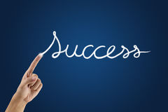 Hand with success word. Blue background Stock Image