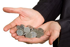 Hand in suit holding coins on white Stock Photography