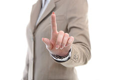 Hand in suit touching something with fingers Stock Image