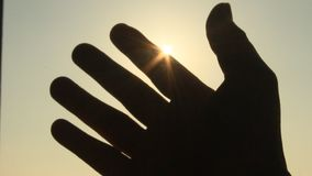 Hand and sun stock footage