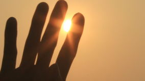 Hand and the sun stock footage